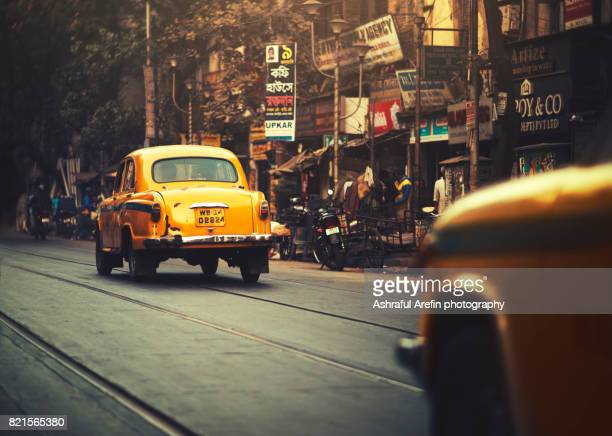 Yellow taxi cab on the street of Kolkata India
