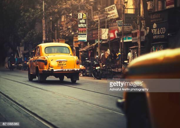 yellow taxi cab on the street of kolkata india - kolkata stock pictures, royalty-free photos & images