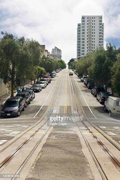 Yellow taxi climbs a steep hill in San Francisco, California, United States of America, North America