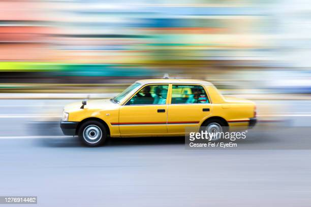yellow taxi in high speed motion - イエローキャブ ストックフォトと画像