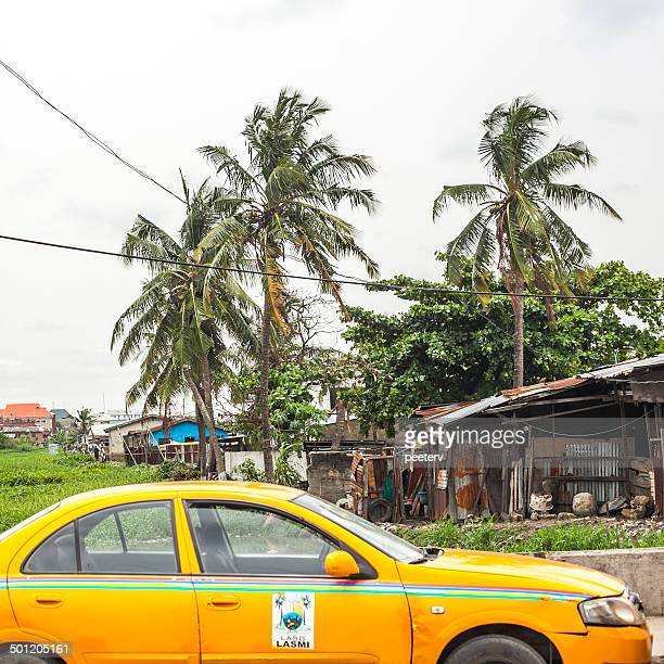 yellow taxi in lagos, nigeria. - lagos stock photos and pictures