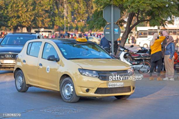 yellow taxi in marrakesh - gwengoat stock pictures, royalty-free photos & images