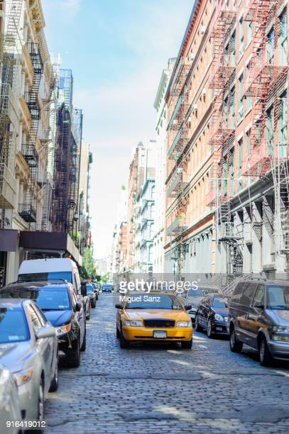 yellow taxi in soho - soho new york stock pictures, royalty-free photos & images