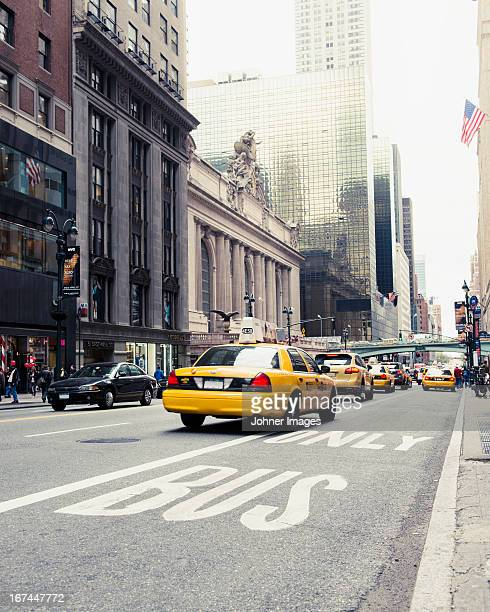Yellow taxi on street
