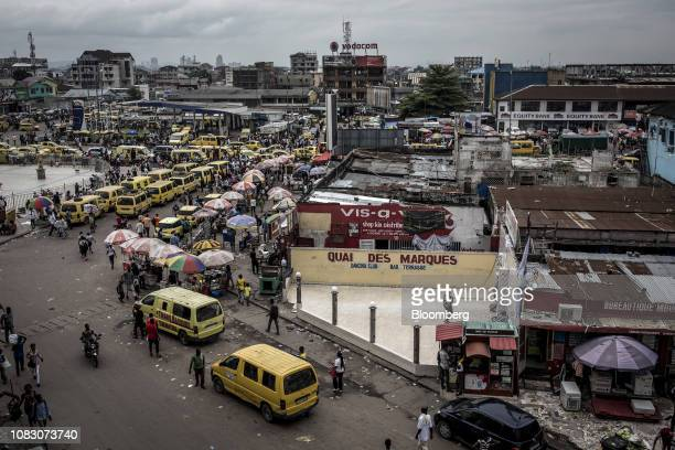 Yellow taxi van vehicles line the streets in the Victoire district of Kinshasa Democratic Republic of the Congo on Friday Jan 11 2019 The disputed...