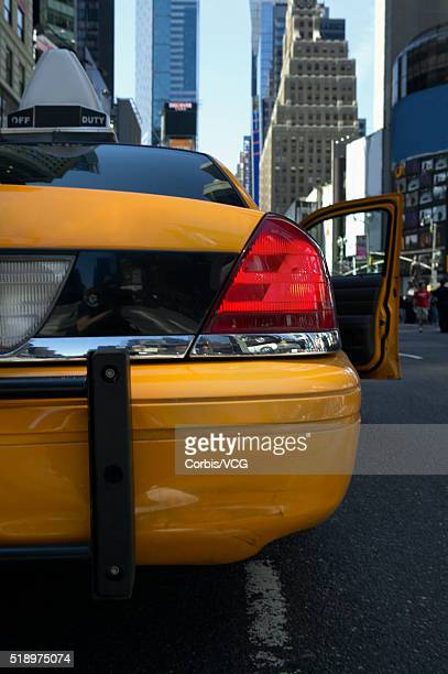 Yellow taxi with open door