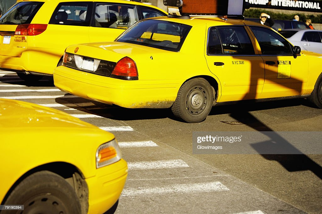 Yellow taxis on a road, Times Square, Manhattan, New York City, New York State, USA : Stock Photo