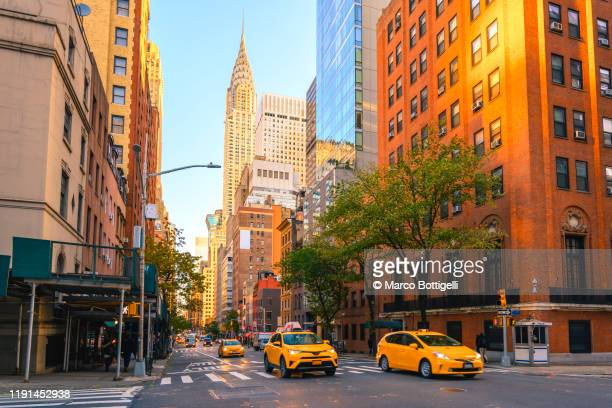 yellow taxis on manhattan streets, new york city - new york city stock pictures, royalty-free photos & images