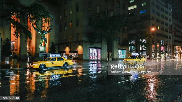 Yellow Taxis On Road In City During Rainy Night