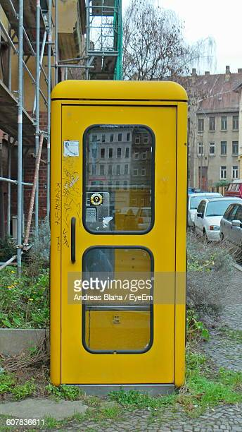 Yellow Telephone Booth On Footpath