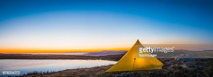 Yellow Tent Camping In Mountain Wilderness Beside Sunrise ...