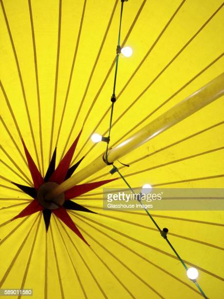 yellow tent ceiling with star design at top of pole - vaudeville stock pictures, royalty-free photos & images