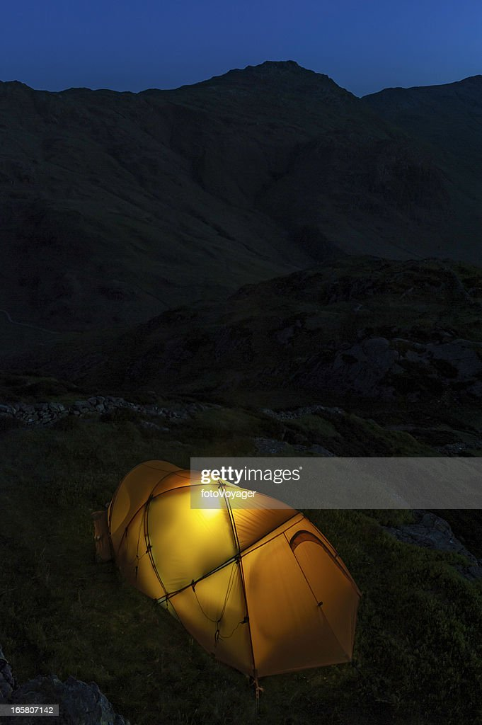 Yellow tent illuminated high on dark mountain  Stock Photo : dark tent - memphite.com