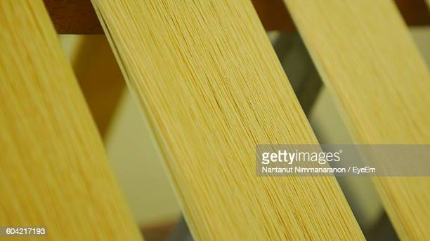 Yellow Threads Weaving On Loom