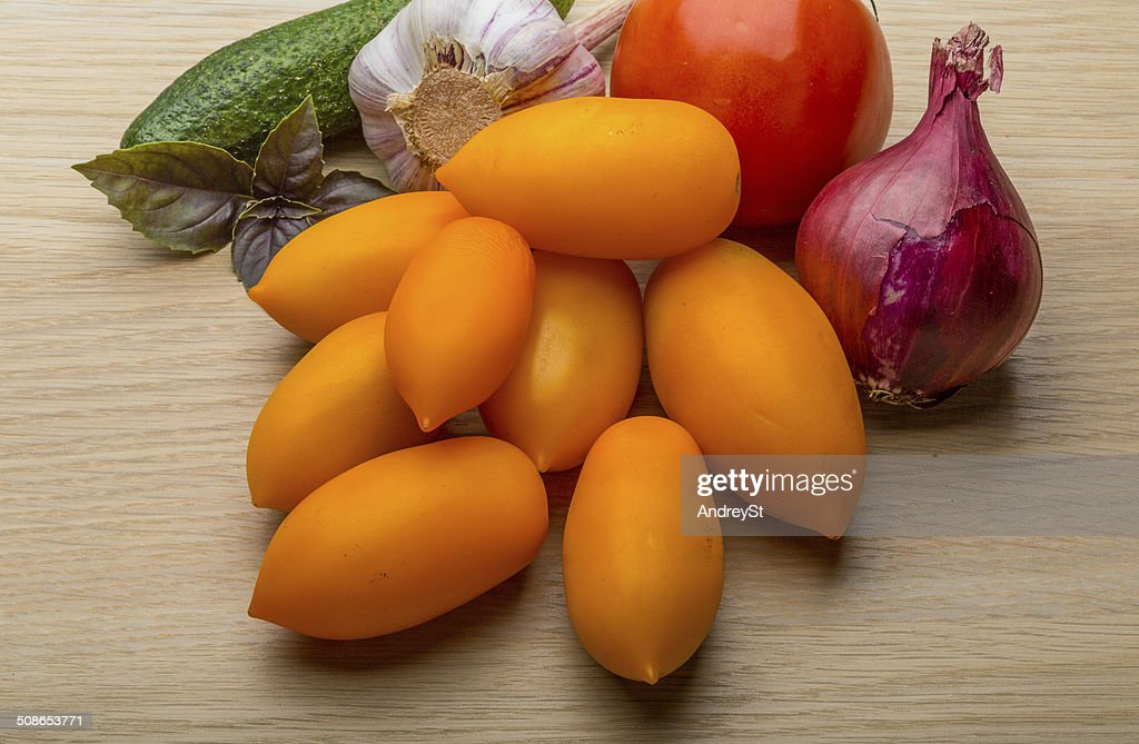 Yellow tomatoes on the board : Stock Photo