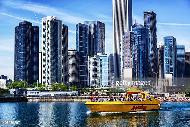 yellow tourst boat, downtown chicago - tourboat stock pictures, royalty-free photos & images