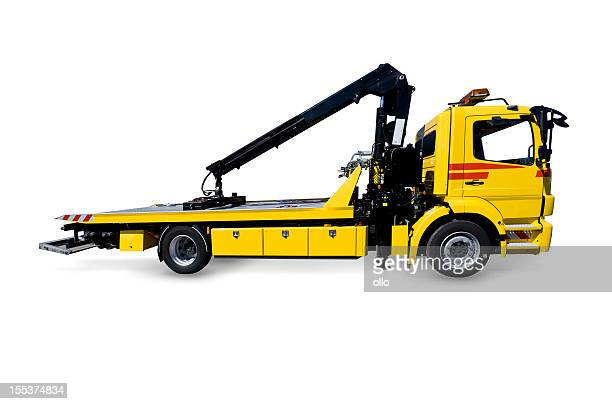yellow tow truck - tow truck stock photos and pictures