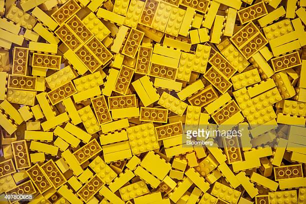 Yellow toy bricks sit in a container at the Lego A/S Factory in Kladno Czech Republic on Monday Nov 16 2015 Lego A/S Europe's biggest toymaker said...