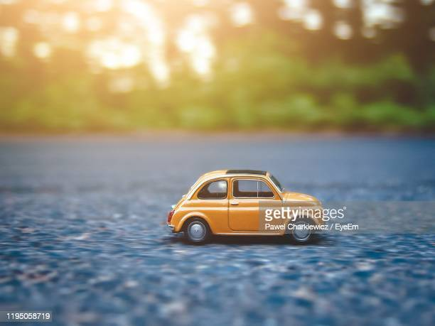 yellow toy car on road - toy car stock pictures, royalty-free photos & images