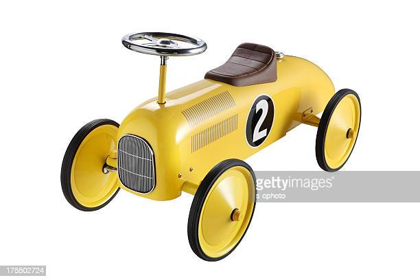 A yellow toy car with big wheels and a number 2 on the side