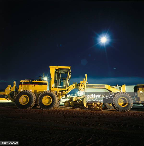 Yellow Tractor at Night