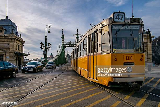 Yellow tram and cars in Budapest