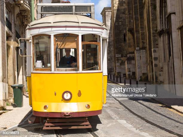 Yellow tram going down to the Sé o cathedral in the neigbourhood of Alfama.