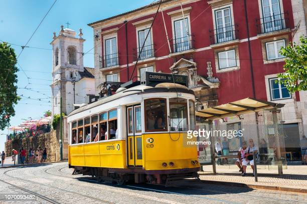 yellow tram in lisbon - alfama stock photos and pictures