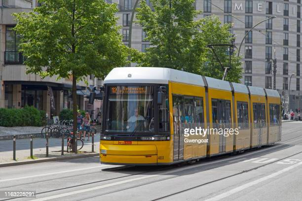 yellow tramway in berlin - gwengoat stock pictures, royalty-free photos & images