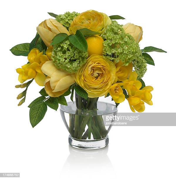 Yellow tulip and ranunculus bouquet on a white background