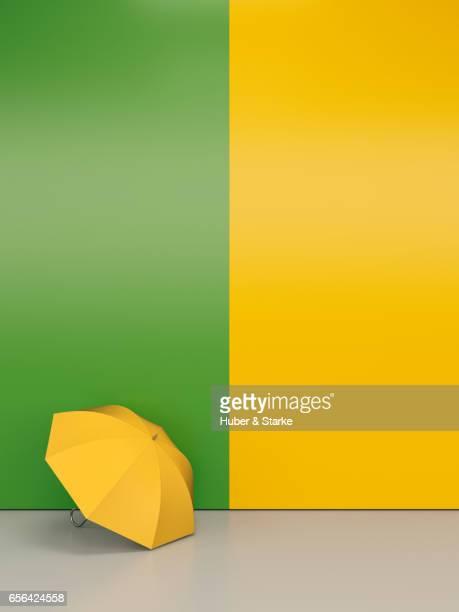 yellow umbrella at colourful wall