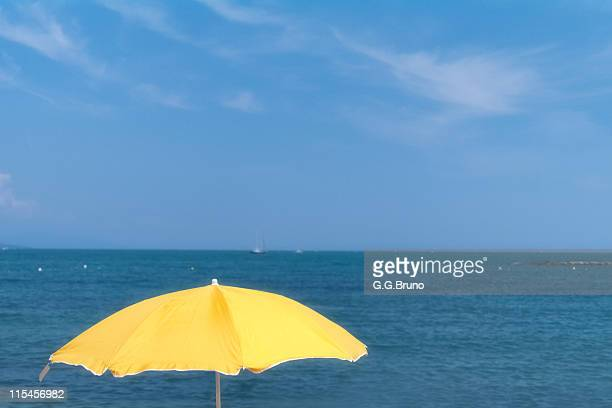 Yellow umbrella with blue sea