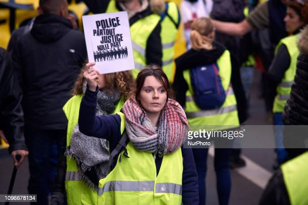 A Yellow Vest brandishes a placard dreading 'Police verywhere justice nowhere' Act XIII dubbed 'Civil disobediencequot' of the Yellow Vest movement...