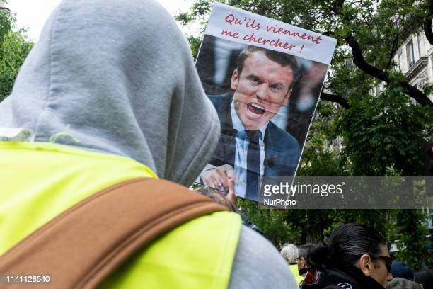 A Yellow Vest brandishes a sign bearing the effigy of the President of the French Republic Emmanuel Macron on which one of his quotes quotLet them...