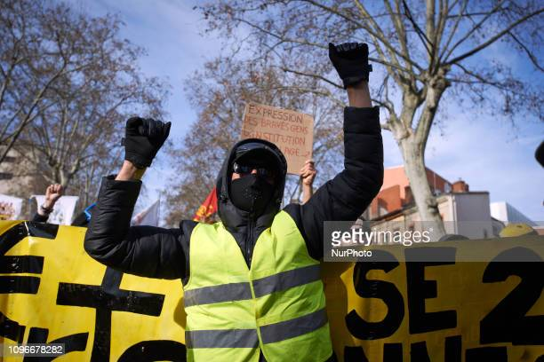 A Yellow vest dances in front of a banner Act XIII dubbed 'Civil disobediencequot' of the Yellow Vest movement begun peacefully but the protest...