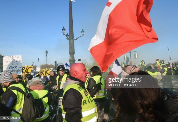A yellow vest Gilet Jaune protestor holds a flag of Free France during an antigovernment demonstration in Bordeaux on January 5 2019 Over the past...