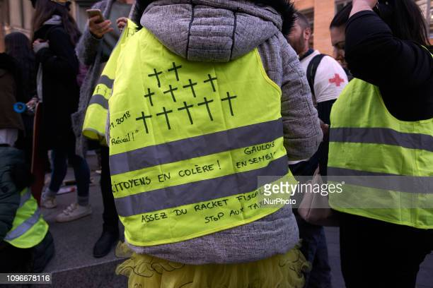 A Yellow Vest has drawn on his yellow vest a little cross for every dead since the beginning of the protests and it reads 'Angry citizens' Act XIII...