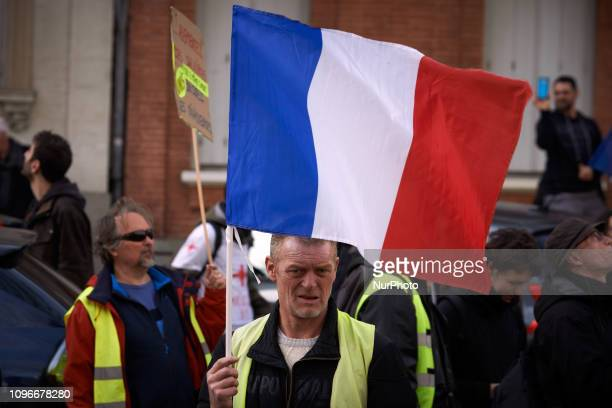 A Yellow vest holds a French flag during the demonstration Act XIII dubbed 'Civil disobediencequot' of the Yellow Vest movement begun peacefully but...