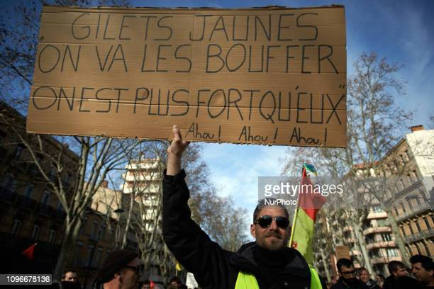 A Yellow Vest holds a placard reading 'Yellow Vests we'll eat them we're stranger then them' Act XIII dubbed 'Civil disobediencequot' of the Yellow...