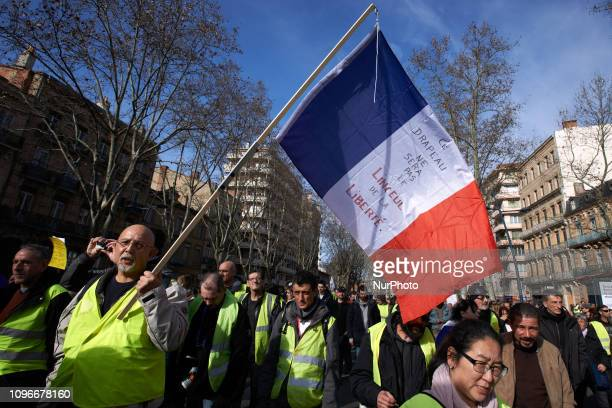 A Yellow Vest holds freng flag reading 'This flag will not be the shroud of Liberty' Act XIII dubbed 'Civil disobediencequot' of the Yellow Vest...