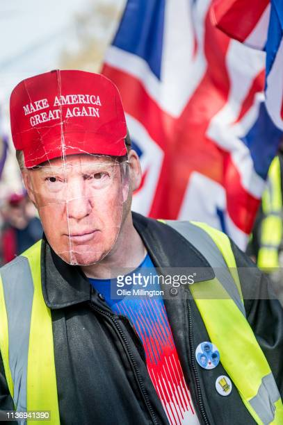 Yellow Vest ProBrexit Protestor seen wearing a Donald Trump mask during a rally at Trafalgar Square on April 13 2019 in London England