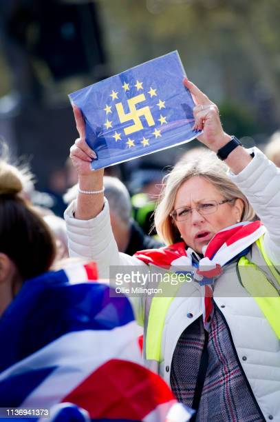 Yellow Vest Pro-Brexit Protestor seen with a EU flag modified with a Swastika during a rally at Trafalgar Square on April 13, 2019 in London, England.