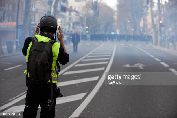 A Yellow Vest protester face riot police amid tear gas Act XIII dubbed 'Civil disobediencequot' of the Yellow Vest movement begun peacefully but the...