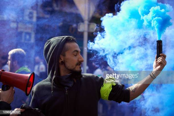 A Yellow Vest protester holds a blue smoke Act XIII dubbed 'Civil disobediencequot' of the Yellow Vest movement begun peacefully but the protest...