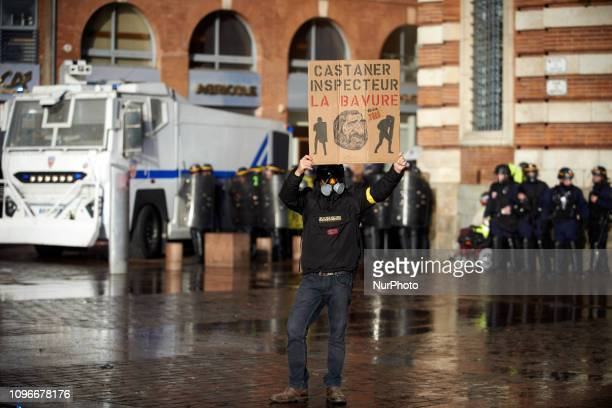A Yellow Vest protester holds a drawing depicting French Interior Minister Castaner as a monkey and it reads 'Castaner inspector Blunder' in front of...