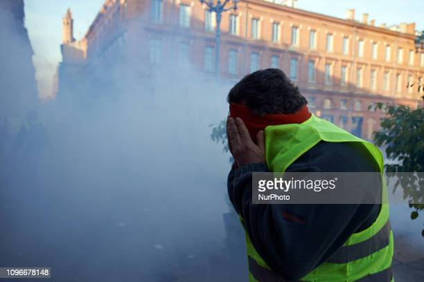 A Yellow Vest protester tries to protect himself from tear gas Act XIII dubbed 'Civil disobediencequot' of the Yellow Vest movement begun peacefully...