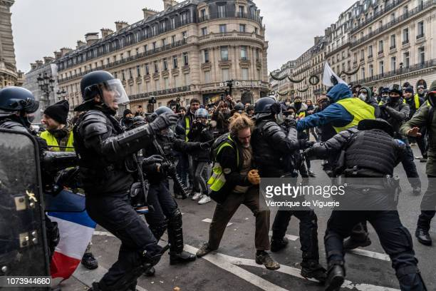 Yellow Vest protesters clash with police on December 15 2018 in Paris France The protesters gathered in Paris for a 5th weekend despite President...