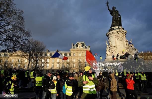 Yellow vest protesters gather at the Republic Square during the 'Act XII' demonstration against deteriorating economic conditions in Paris, France on...