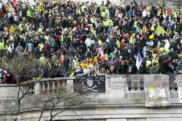 Yellow Vest protesters gather in front of the Sacre Coeur Basilica in Montmartre in Paris on March 23 during an antigovernment demonstration called...