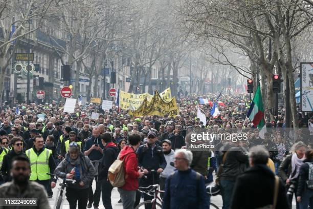 Yellow Vest protesters walk on the Boulevard SaintMichel in Paris on March 23 during an antigovernment demonstration called by the 'Yellow Vest'...